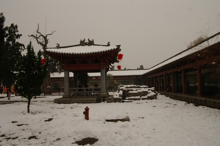 heavy snow: Landscape view of an ancient architectural building during heavy snow Editorial