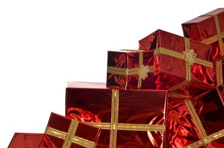 Pile of Christmas presents wrapped in red foil on white background Stock Photo - 3776951