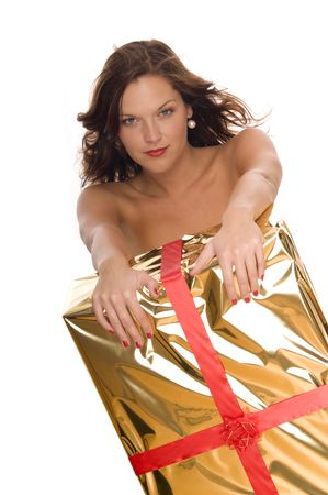 Beautiful naked model behind a big golden Christmas gift on white background Stock Photo - 3776949