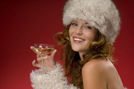 Beautiful lady with fur hat toasting with champagne on red background Stock Photo - 3776956