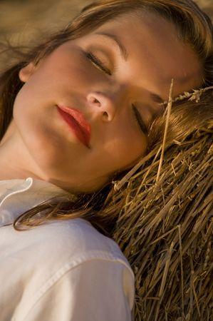 Young beautiful woman enjoying the sunset Stock Photo - 3787841