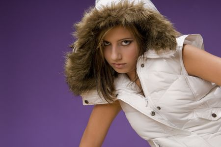 Young fashion model wearing warm white jacket without sleeves Stock Photo - 3787834