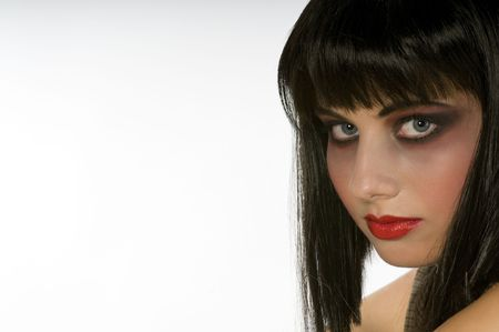 Young fashion model portrait with black wig. Copy space on left side. Stock Photo - 3787828