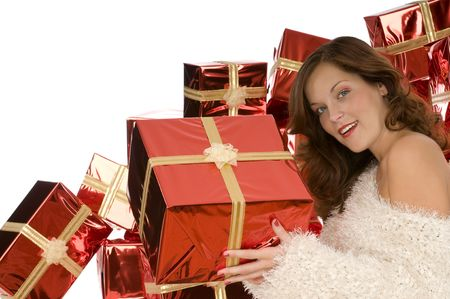 Beautiful lady giving a present in front of pile of gifts Stock Photo - 3787842