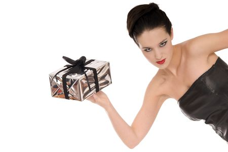 Mystic looking young lady in black with a silver Christmas gift isolated on white background photo