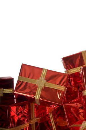 Pile of Christmas presents wrapped in red foil on white background Stock Photo - 3792066