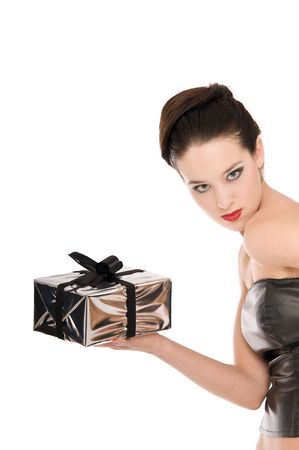 anniversary sexy: Fashion model in black leather corset holding a silver Christmas present isolated on white background