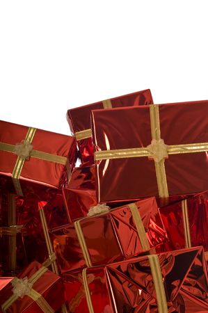Pile of Christmas presents wrapped in gold foil on red background on white background Stock Photo - 3792067