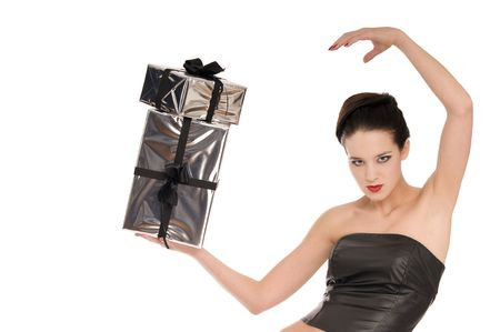 Beautiful woman in black leather corset balancing with two silver Christmas presents isolated on white background photo
