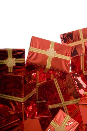 Pile of Christmas presents wrapped in gold foil on red background on white background  on white background Stock Photo - 3792068