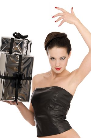 Young woman in black leather corset holding two silver Christmas presents isolated on white background Stock Photo - 3787827