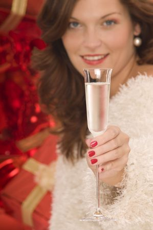 Beautiful lady toasting with a champagne glass in front of pile of gifts Stock Photo - 3787825