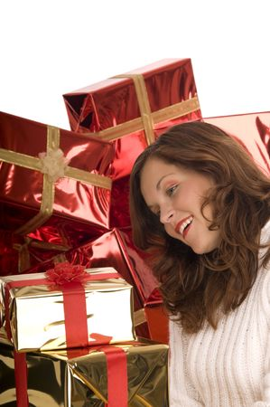 Beautiful model with golden Christmas gifts in front of pile of gifts Stock Photo - 3792592