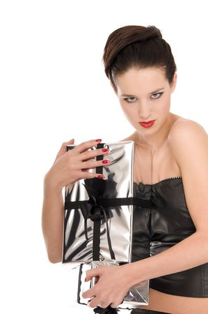 Fashion model grabbing with both hands Christmas gifts isolated on white background photo