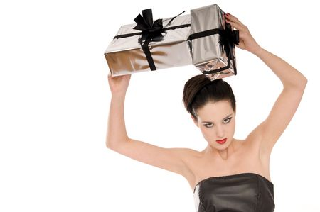 Young woman holding Christmas gifts above her head Stock Photo - 3818339