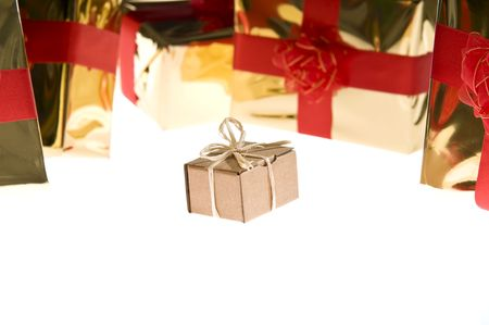 Simple present isolated on white background surrounded by glossy wrapped presents photo