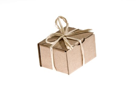 Simple present isolated on white background made from recycled cardboard photo