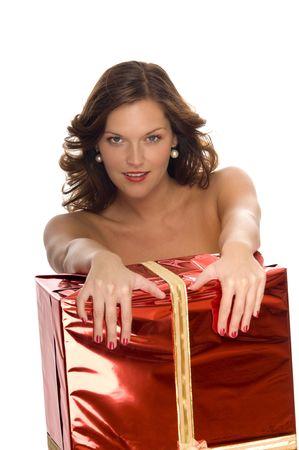 Beautiful naked model behind a big Christmas gift on white background Stock Photo - 3792589