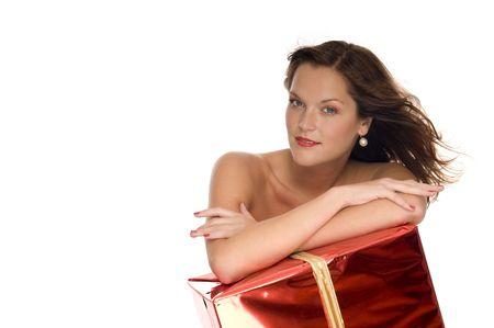 Beautiful naked model behind a big Christmas gift on white background Stock Photo - 3792588