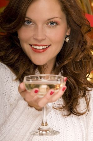 Portrait of beautiful lady toasting with a coupe of champagne, blurred foreground Stock Photo - 3794921