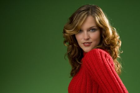 Dark blond beauty on Christmas green background with red sweater Stock Photo - 3794922