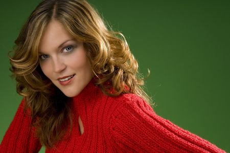 Dark blond beauty on Christmas green background with red sweater Stock Photo - 3794939