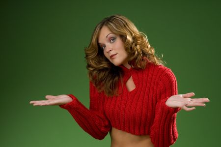 Indecisive woman on Christmas green background with red sweater Stock Photo - 3794918