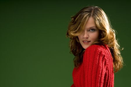 Dark blond beauty on Christmas green background with red sweater Stock Photo - 3794925
