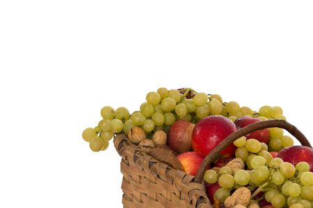 Basket full of fruits isolated on white photo