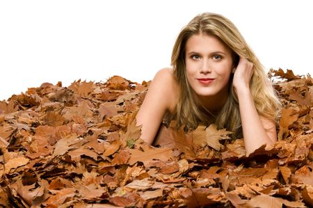 Young blond woman covered by dried leaves on white background Stock Photo - 3837008