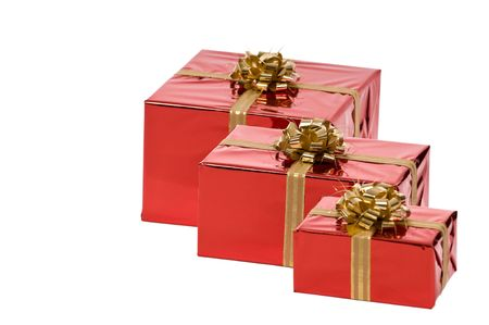 Three Christmas gifts with gold bow isolated on white background Stock Photo - 3852648