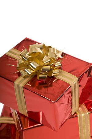 Beautiful red Christmas gifts with gold bow on white background Stock Photo - 3852657
