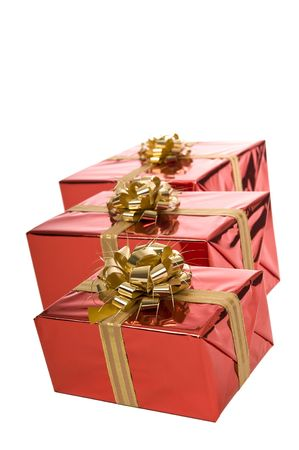 Row of three red Christmas presents isolated on white background Stock Photo - 3852651