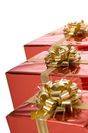 Close-up of a row of red Christmas presents on white background Stock Photo - 3852656