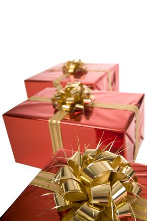 Close-up of golden bow on red Christmas present on white background Stock Photo - 3852649