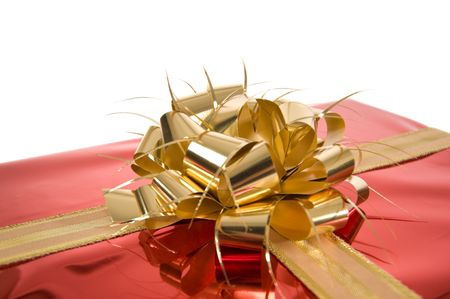Close-up of gold bow on red Christmas present on white background Stock Photo - 3852652