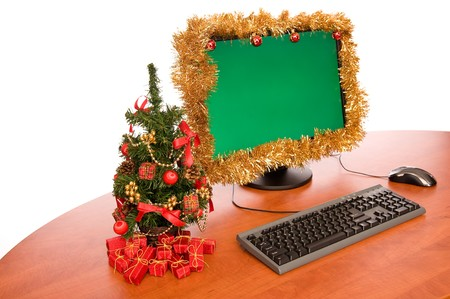 Office desk with Christmas tree on white background photo