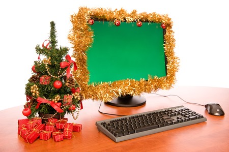 Office desk with beautiful Christmas decoration on white background photo