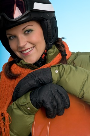 Cheerful snowboard girl ready for winter on blue background photo