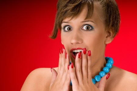 Surprised young woman on red background Stock Photo - 4242961
