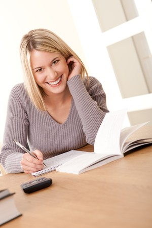 Blond girl studying home Stock Photo - 4570503