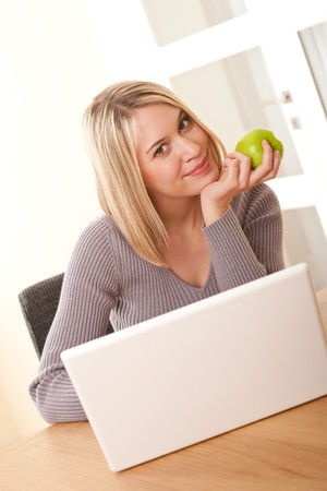 Young blond woman with laptop having break Stock Photo - 4570494