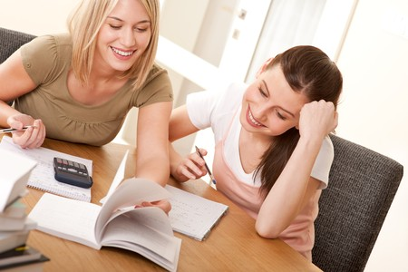 Two girls studying together Stock Photo - 4570504