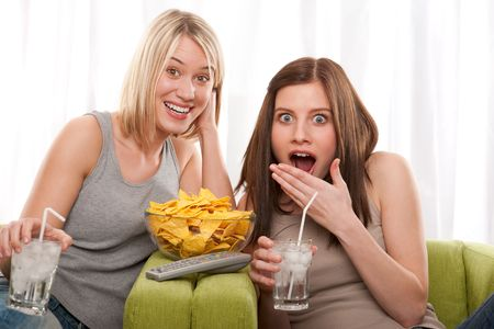Shocked in front of TV, having cold drink Stock Photo - 4580036