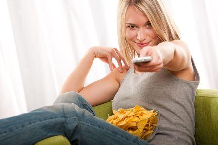Blond teenage girl sitting on green armchair Stock Photo - 4608325