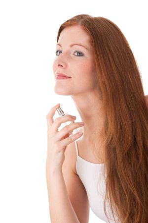 Young red hair woman applying perfume on white background Stock Photo - 4719879