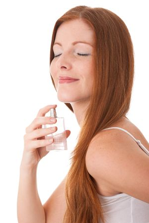 Young red hair woman enjoying smell of perfume on white background Stock Photo - 4719926