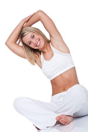 estiramientos: Mujer joven en el ejercicio de fondo blanco