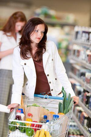 Beautiful brunette in cosmetics department shopping Stock Photo - 4893173