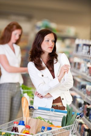 Attractive woman shopping in cosmetics department photo